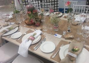 White picnic table and hessian