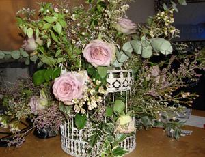 Large birdcage with roses