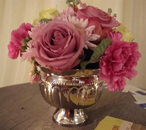 Silver vase with roses