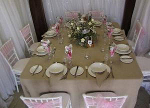 Stone tablecloth with Birdcage and flowers with pink sashes