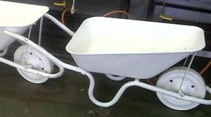 White Wheel Barrows (Popular item for beers and coolers at Weddings)