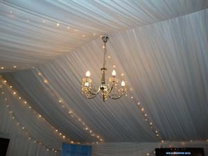 Chandelier with draping & fairy lights