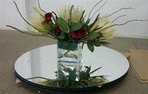 Rectangle glass vase on mirror