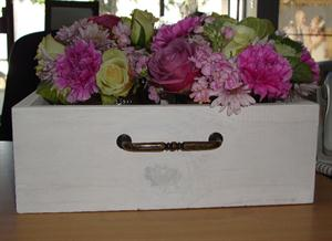 Wooden draw flower arrangement